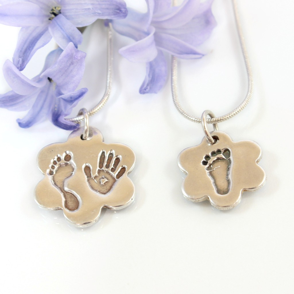 silver hand print and footprint pendant by impressions to keep