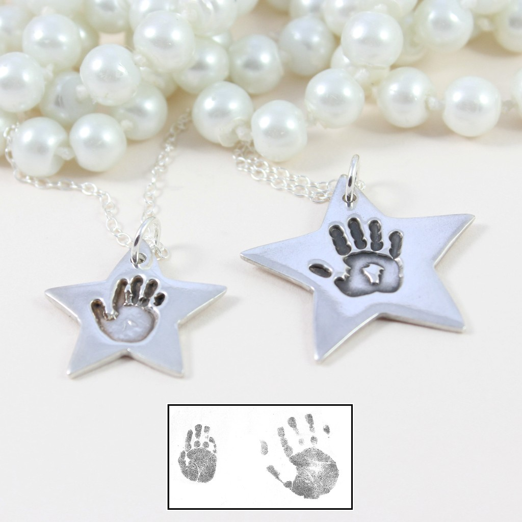 Silver star hand print necklace