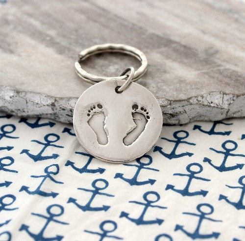 round silver hand print keyring