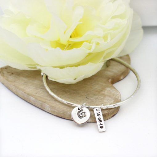 silver bangle and silver date charm