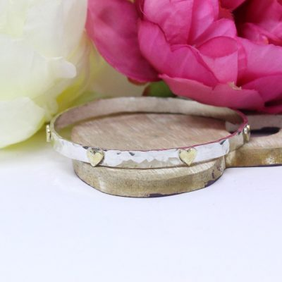 personalised silver bangle with milestone hearts